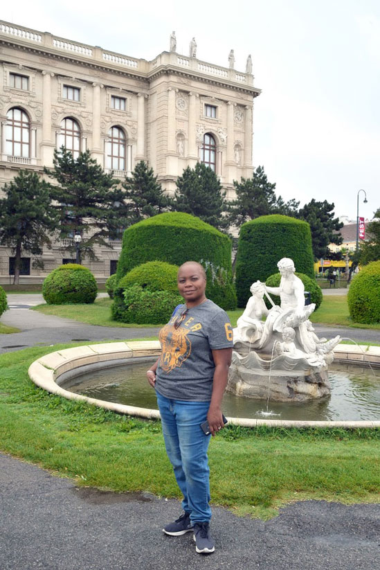 woman standing in front of fountain - how to spend 7 days in Vienna guide