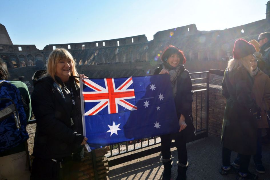 2 women with Australian flag at the Colosseum Underground Tour Rome