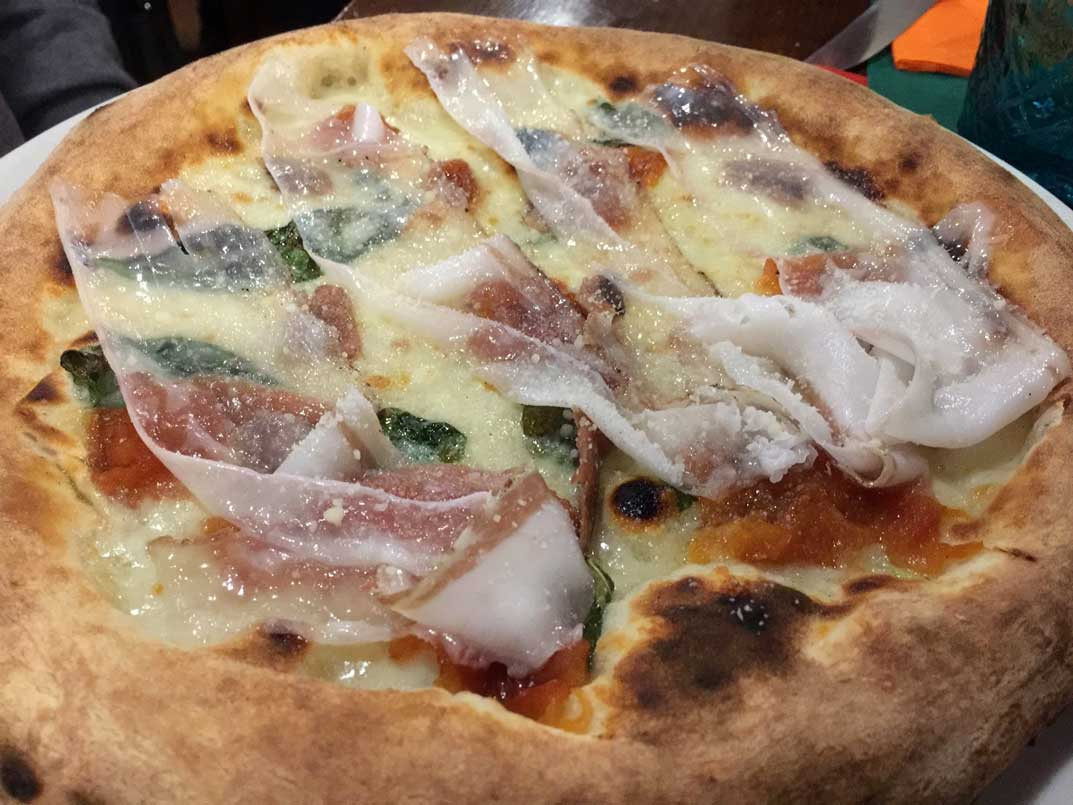 pizza topped with lard. Verona