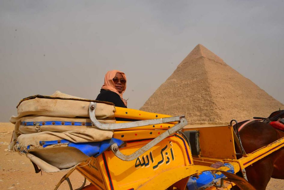 woman in carriage at the pyramids of giza