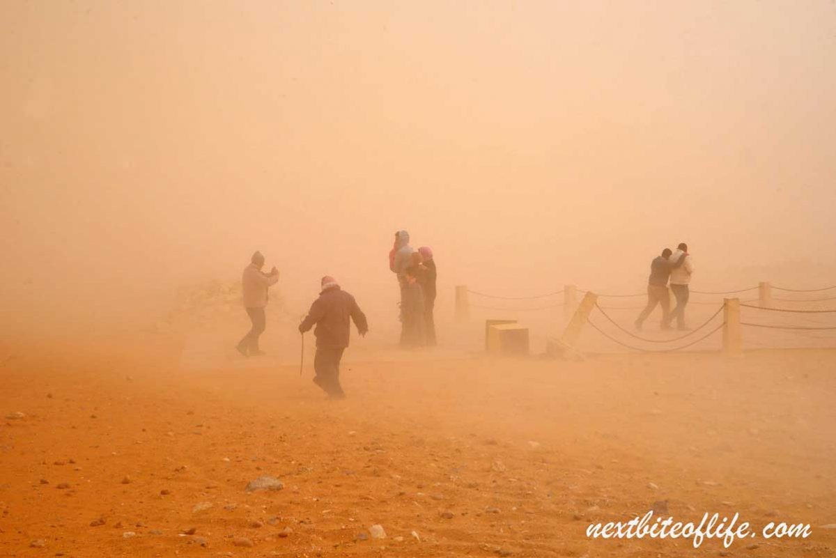 sand storm at pyramids of Giza with people