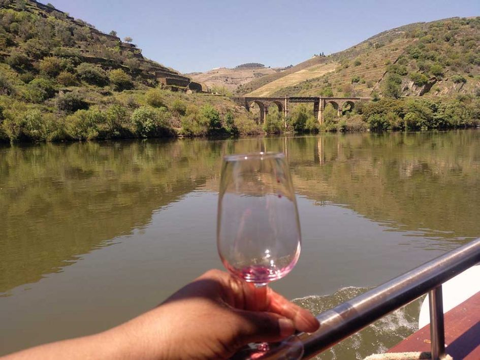 Douro Valley view with empty wineglass