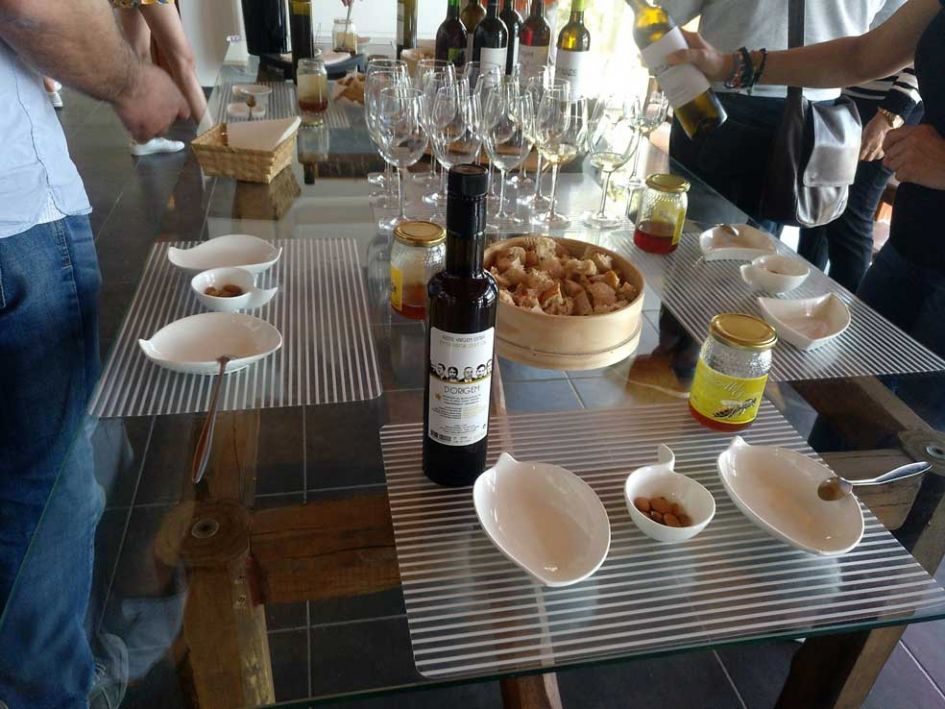 samples of wine, honey and almonds