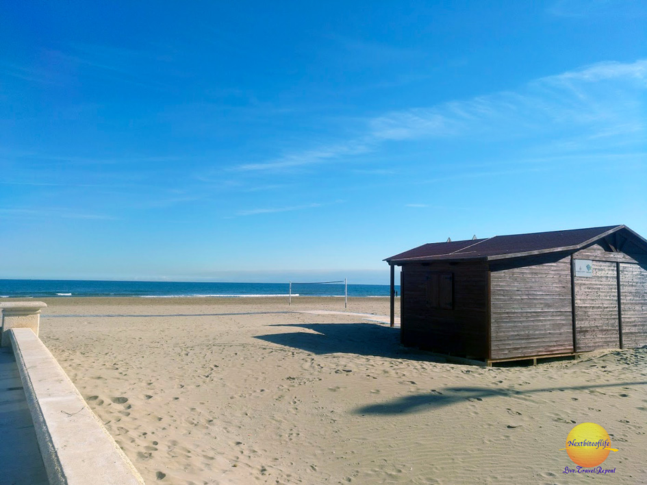 17 reasons not to visit Valencia . Malvarrosa beach with shack and sand.