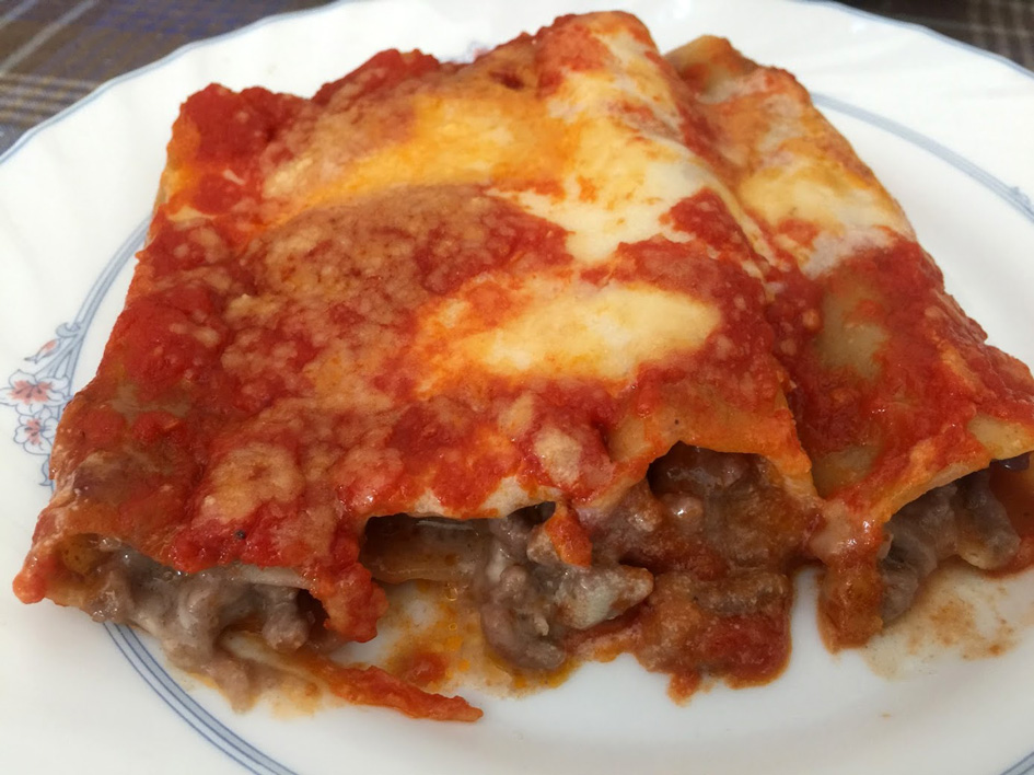 cannelloni with sauce on a plate