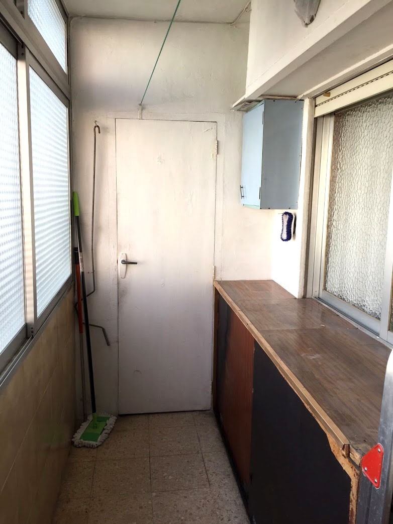 rear balcony in white with cabinet, making changes renovating our Valencia Spain flat