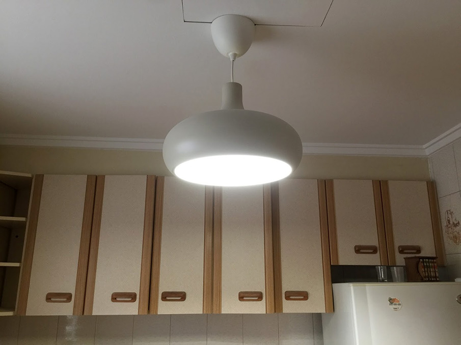 Flat refurbishment in Spain Kitchen cabinets and light pendant