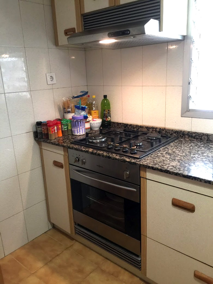Our remodeled Valencia Spain flat kitchen with new stove and oven