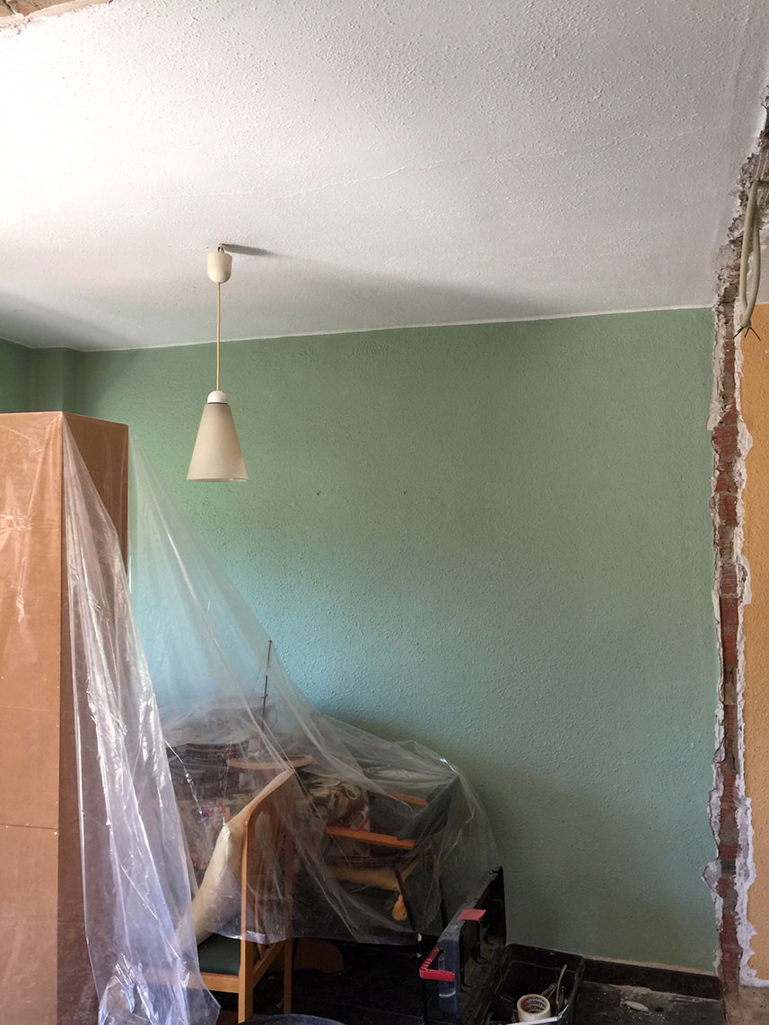 Our Valencia Spain flat renovation in progress. Green bedroom with walls taken down