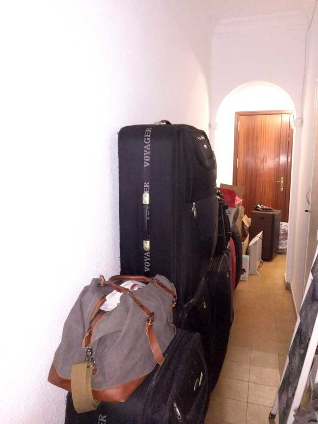 Luggage sitting in hallway