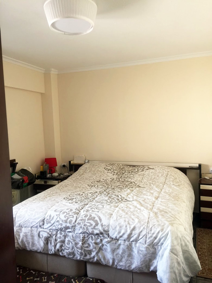 bedroom with king size bed and creme color walls on our Valencia Spain flat remodel