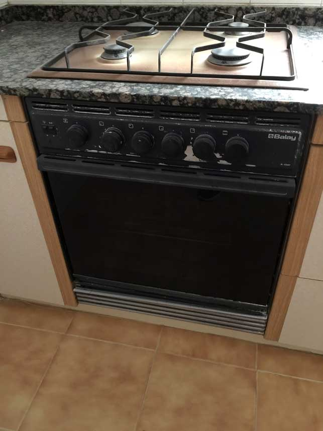 Tips for buying property in Spain includes old things like this stovetop that needs updating