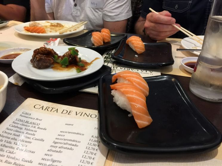 sushi with salmon plates