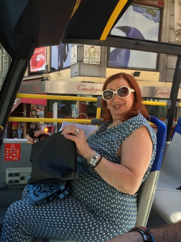 woman on Madrid hop on hop off bus tour