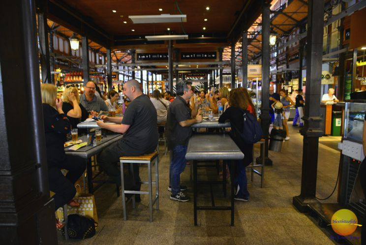 people at the mercado San Miguel eating