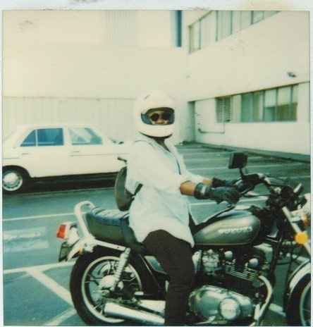 woman on motorcycle in the 90's