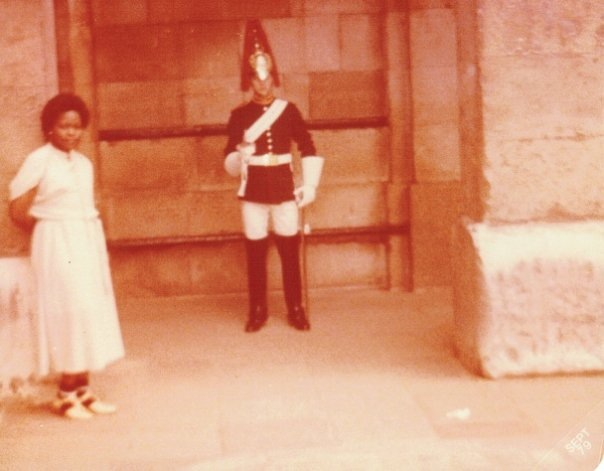 black girl posing with Buckingham palace guard