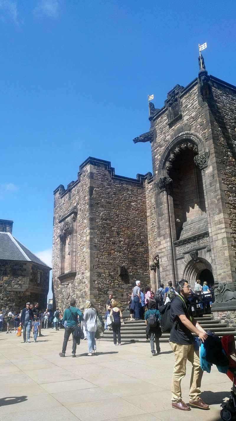 Edinburgh castle grounds with brown building and people
