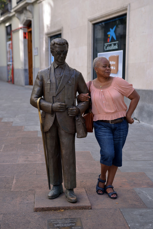 50 before 50 bucket list woman posing with statue bronze in Madrid