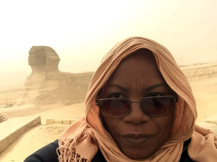 woman with head scarf selfie with Sphinx