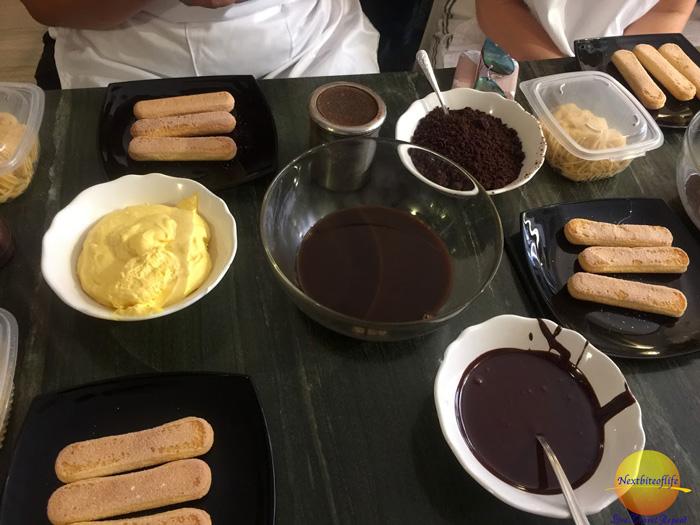 Tiramisu making ingredients on table