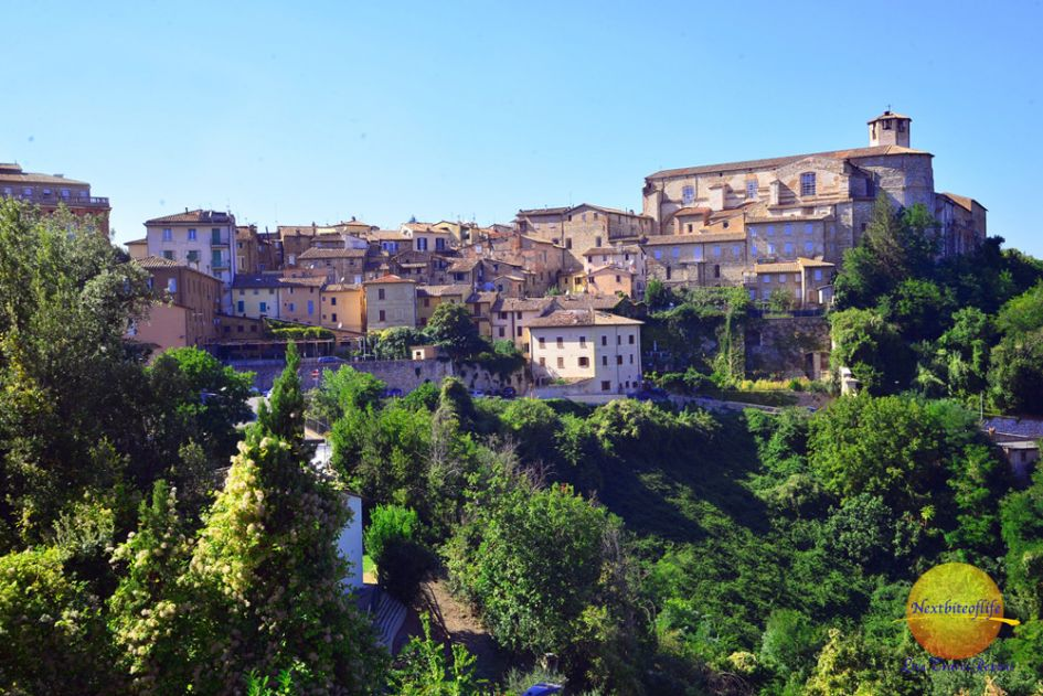 Pergia Italy hilltown view with houses and green trees