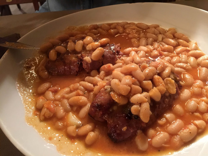 plate of beans and sausage in Siena. Food is one of the many reasons to visit Siena in the fall