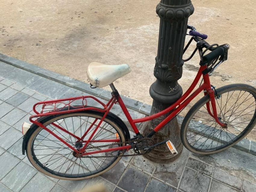 old red vintage bike chained to a post, 2019 review year how we keep healthy