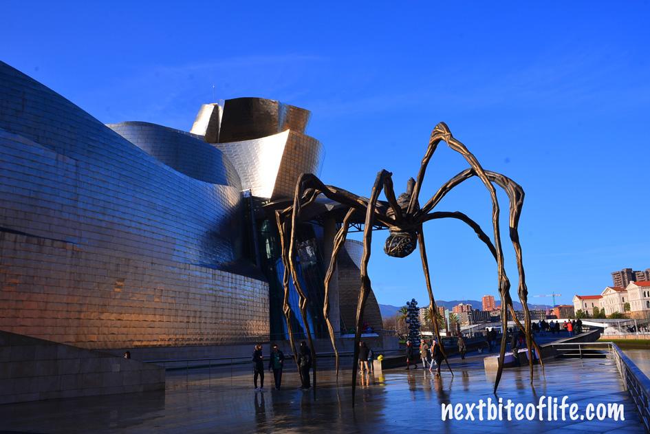 Guggenheim museum Bilbao with metal spider in front