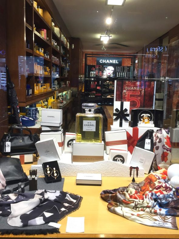 Santander Spain visit guide store window with scarf and big channel 5 bottle