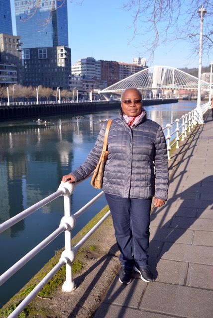 black woman with Zurubiri bridge in background