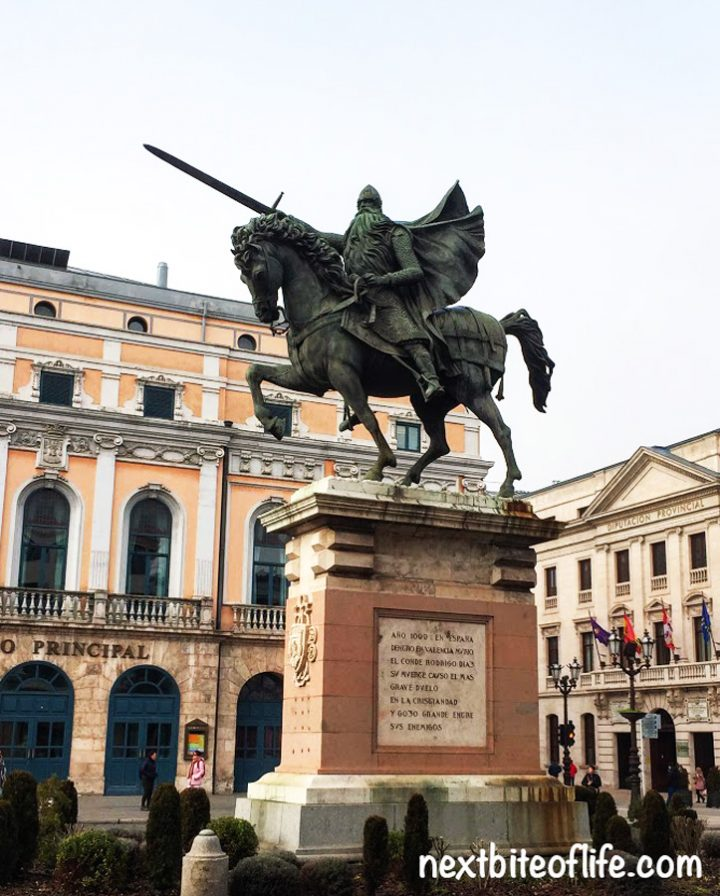 El Cid statue in Burgos Spain guide seated on horse and drawn sword in brass