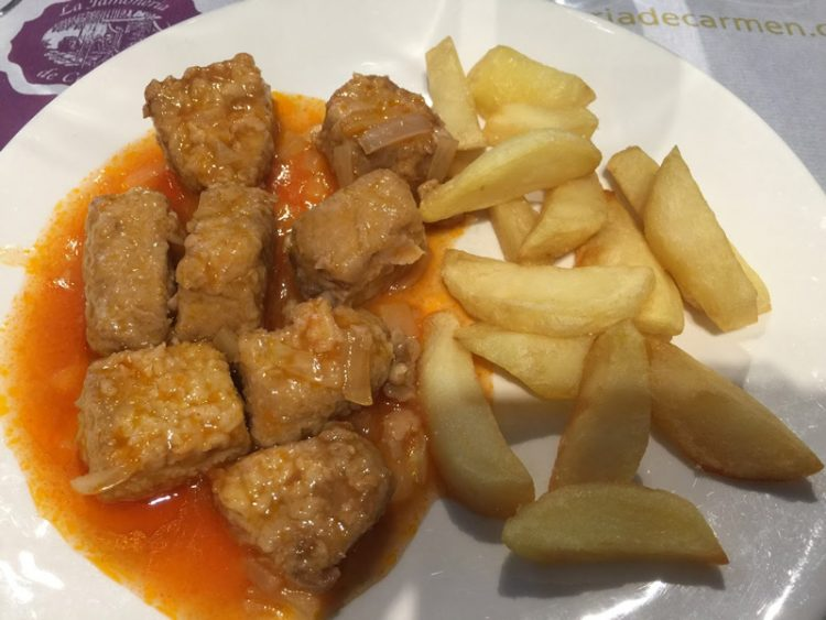 dinner plate with pork and fries