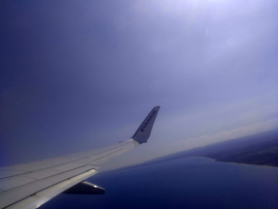 ryanair wing in cloud leaving italy