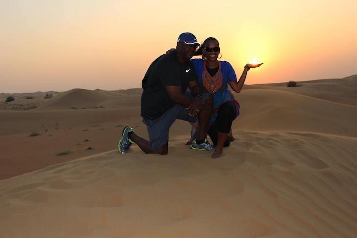 couple posing against sunset backdrop