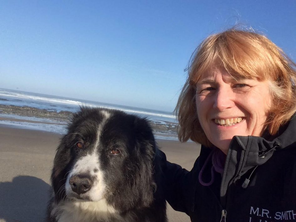 Life in Canada with Cheryl Rhodes - woman and dog on beach