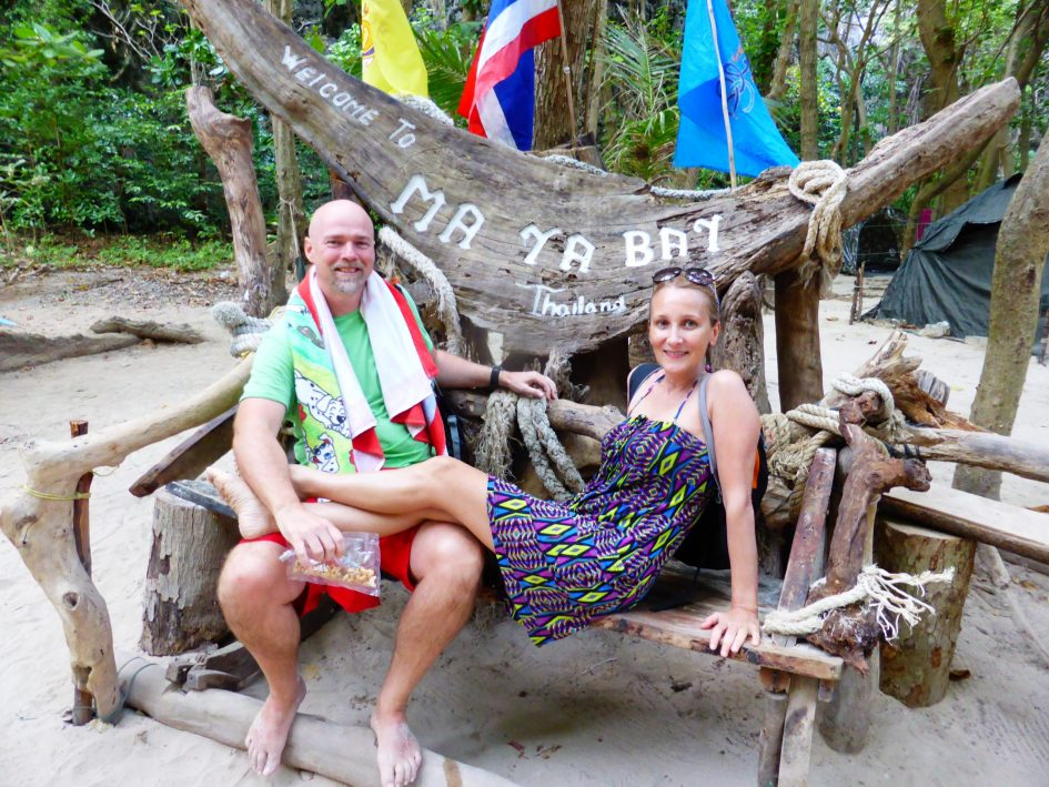Travel in Asia during the pandemic couple seating on a bench in Thailand