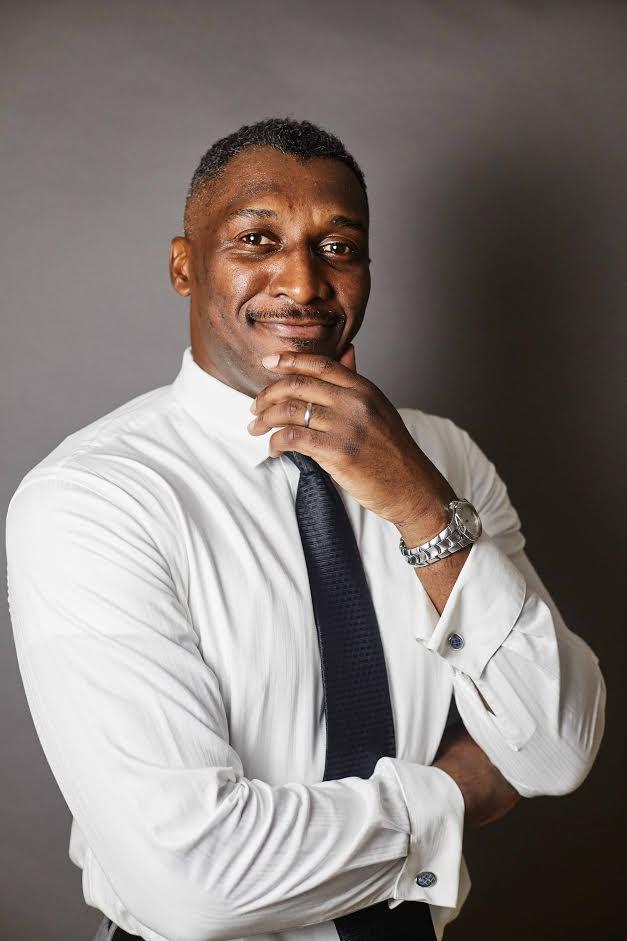 black man in white shirt posing in studio. Designing your expat life