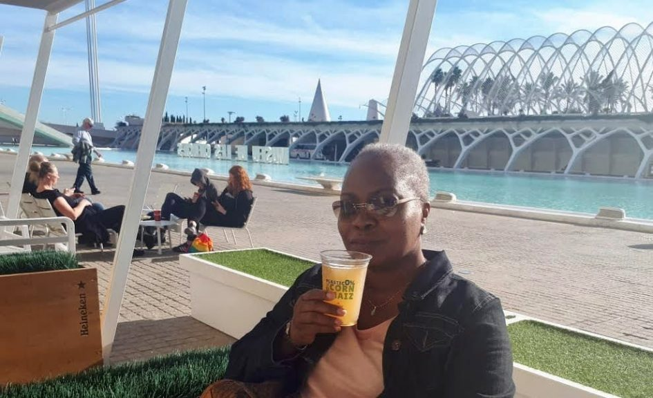 black woman sipping drink in Valencia City of Arts