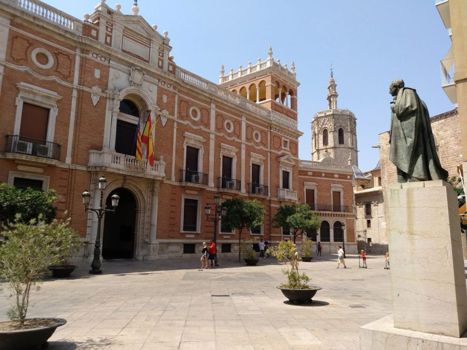Valencia Spain plaza with pope statue and pink building