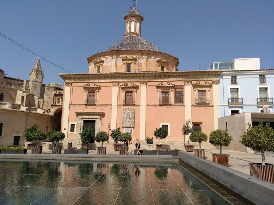 Valencia Spain water fountain view in front of church pink