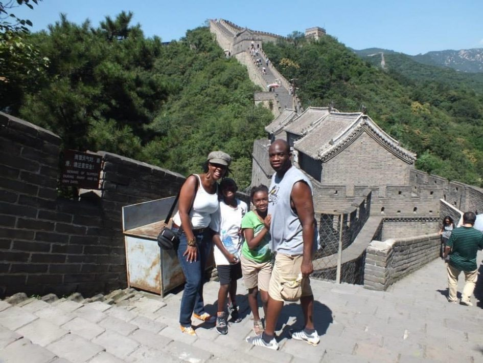 coach and hubby and kids with wall of China in the background